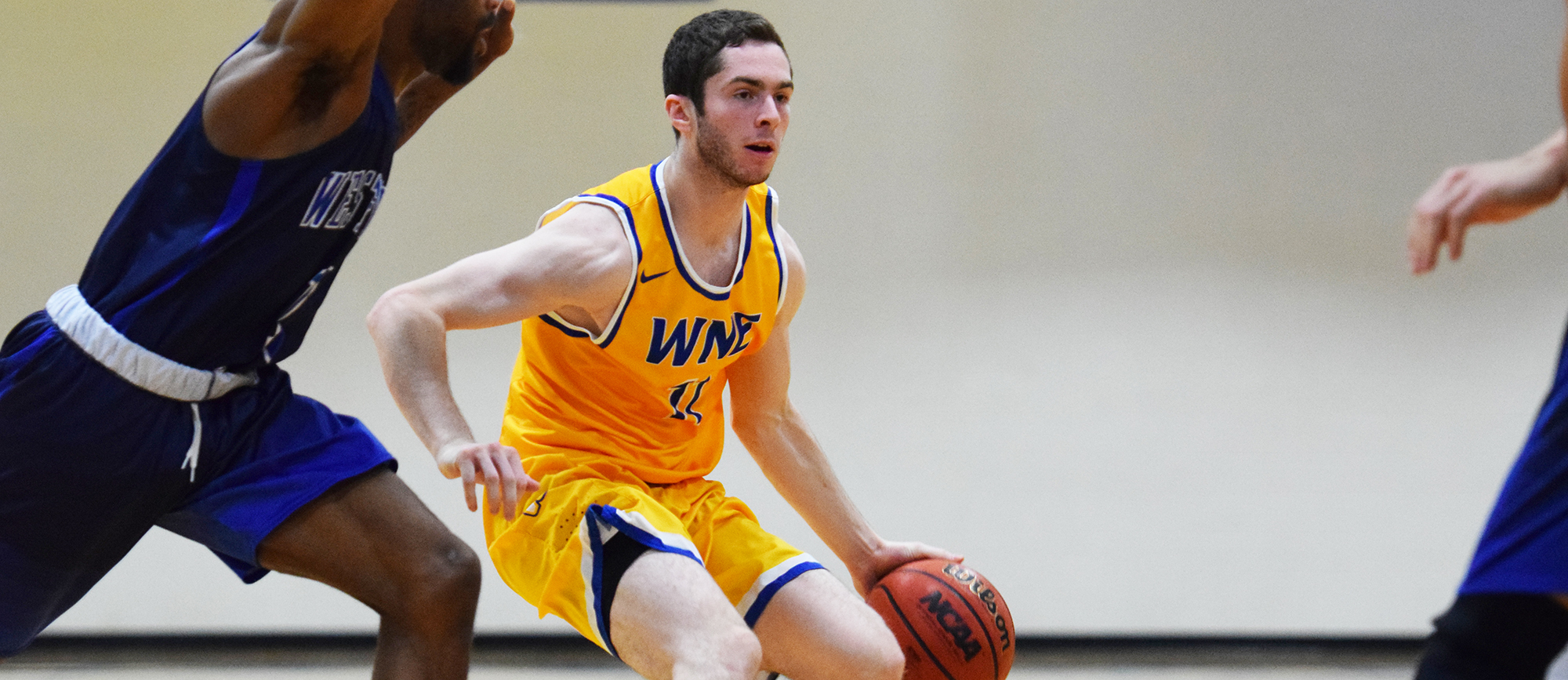 Sophomore Mike McGuire scored 12 of his 14 points in the second half of Western New England's 92-83 victory over Westfield State on Saturday (photo by Rachael Margossian).