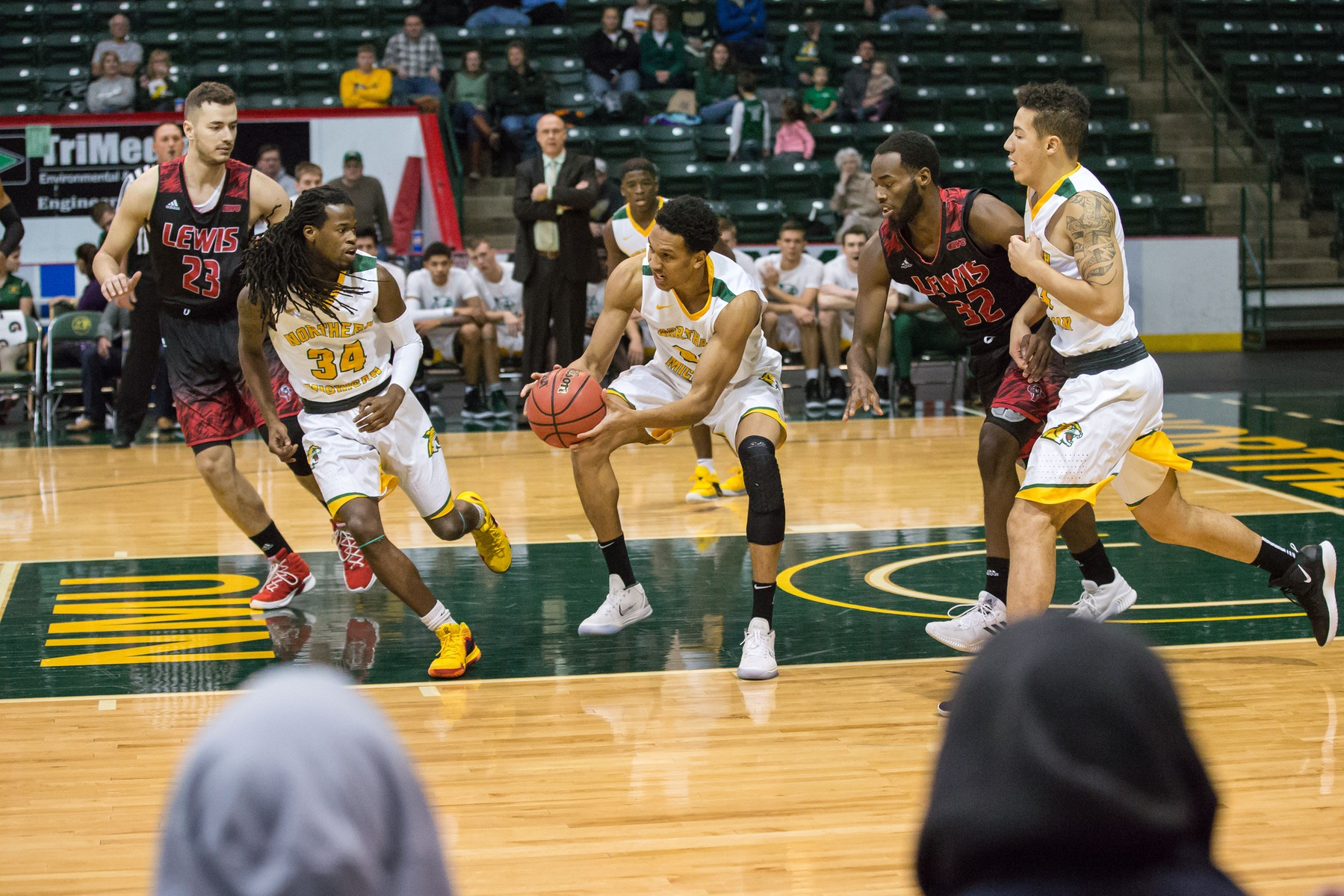 Two Reach 20 Points but NMU Suffers First Setback of Season