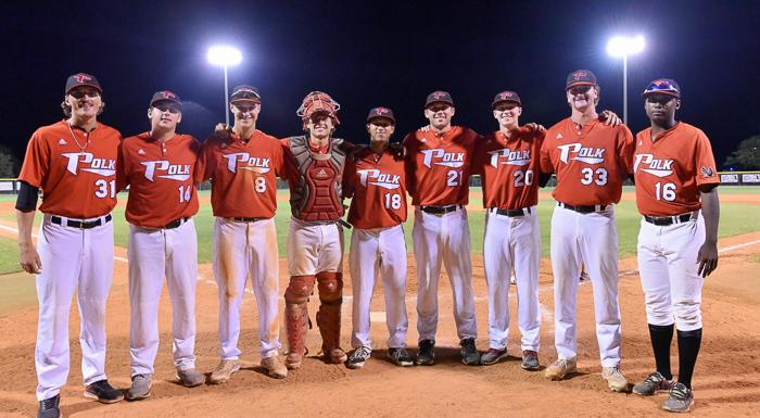 Eagles sophomores gather at home plate after playing their final home game. From left: Bryce Van Horn, Danny Madden, Zach Scott, Cody Oerther, Julio Blanco, Pat Doudican, Alec Barger, Jared Freilich, and Chavez Fernander. (Photo by Tom Hagerty, Polk State.)