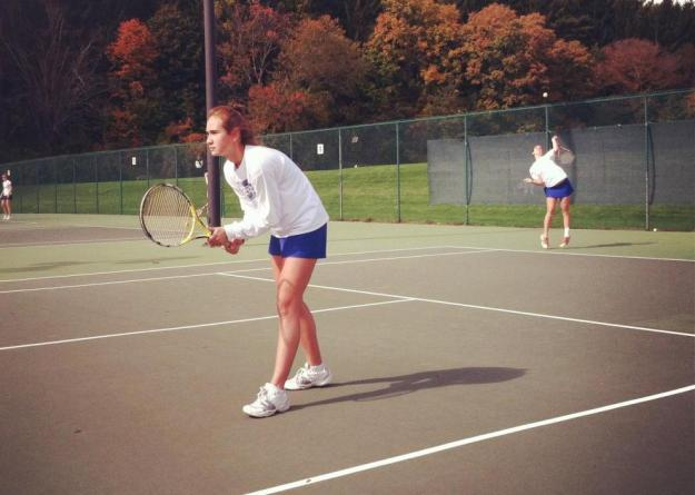 Elizabeth DiFilippo '15 serving with Ana Gwozdz '14 at net during competition at the New England Women's Invitational Tennis Tournament at Smith College on Saturday (photo by Erica Shay '15).