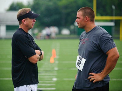 "Former Bulldog Jake Visser (right) talks with sports coordinator Mark Ellis (left) at tryouts for the movie ""Touchback"" (Photo courtesy of Joel Hawksley - MLive.com)"