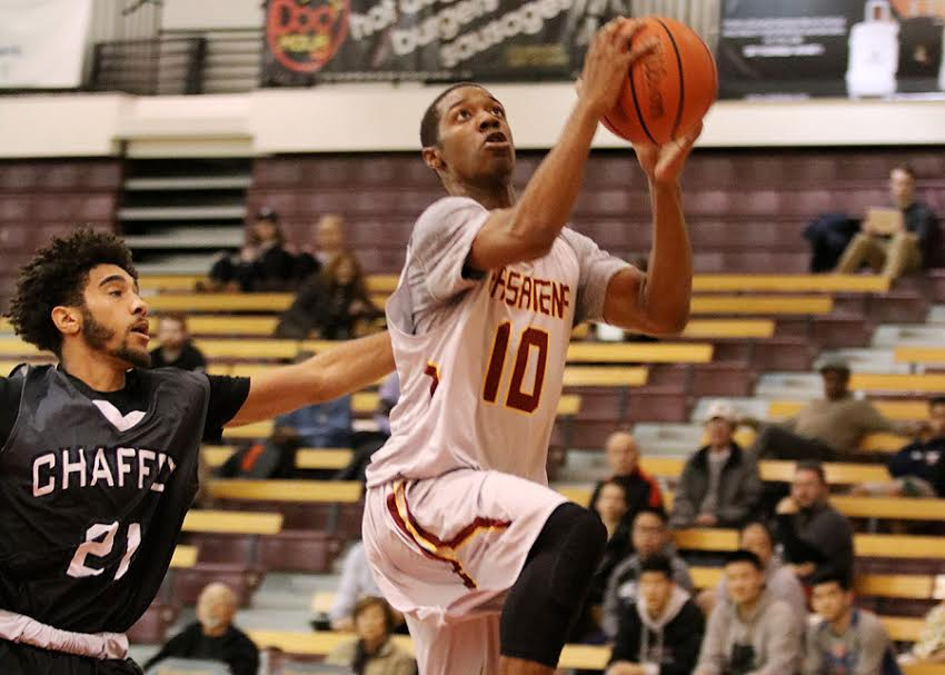 Lancer Eris Winder drives to the basket on Wednesday in PCC's loss to Chaffey, photo by Richard Quinton.