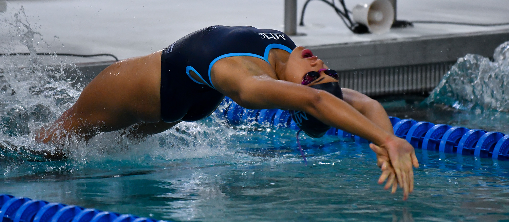 image of an MHC swimmer at the start of the backstroke