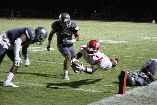Mesa's Sonnie Richardson (#1) dives into the endzone for the deciding touchdown against the Scottsdale Artichokes Saturday night.