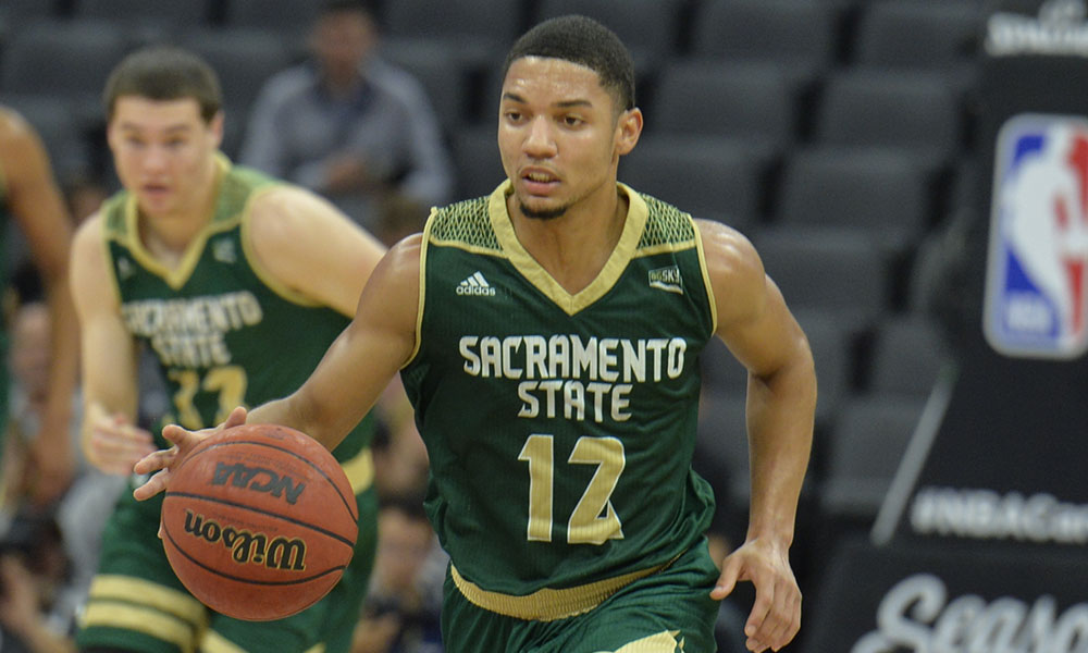 MEN'S HOOPS RIDES BIG SECOND HALF AND TOLBERT'S 26 POINTS TO ROAD WIN AT PORTLAND STATE