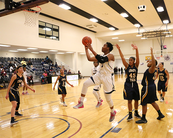 Sophomore Kyesha Lewis (0) drives pass Chattahoochee Tech defenders. 