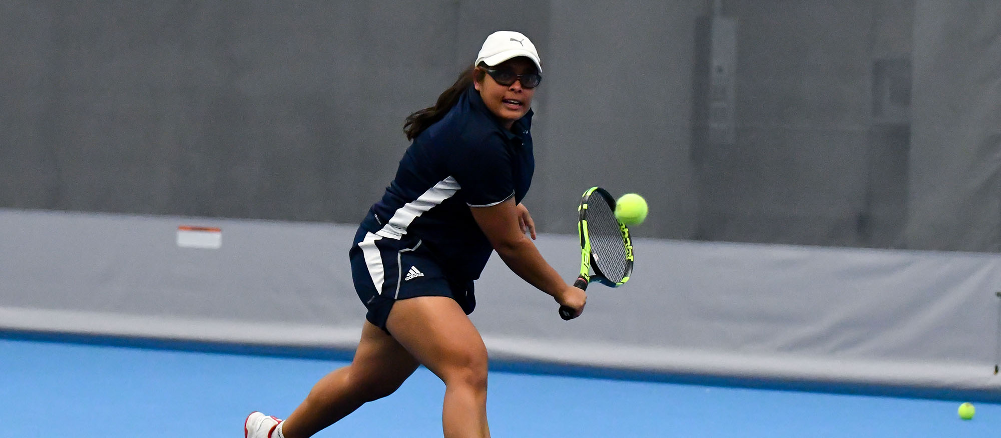 Action photo of senior tennis player Ishita Tibrewal.
