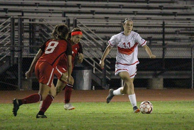 Alyssa Felder dribbles up field Thursday night against Cochise College. (Photo by Aaron Webster)