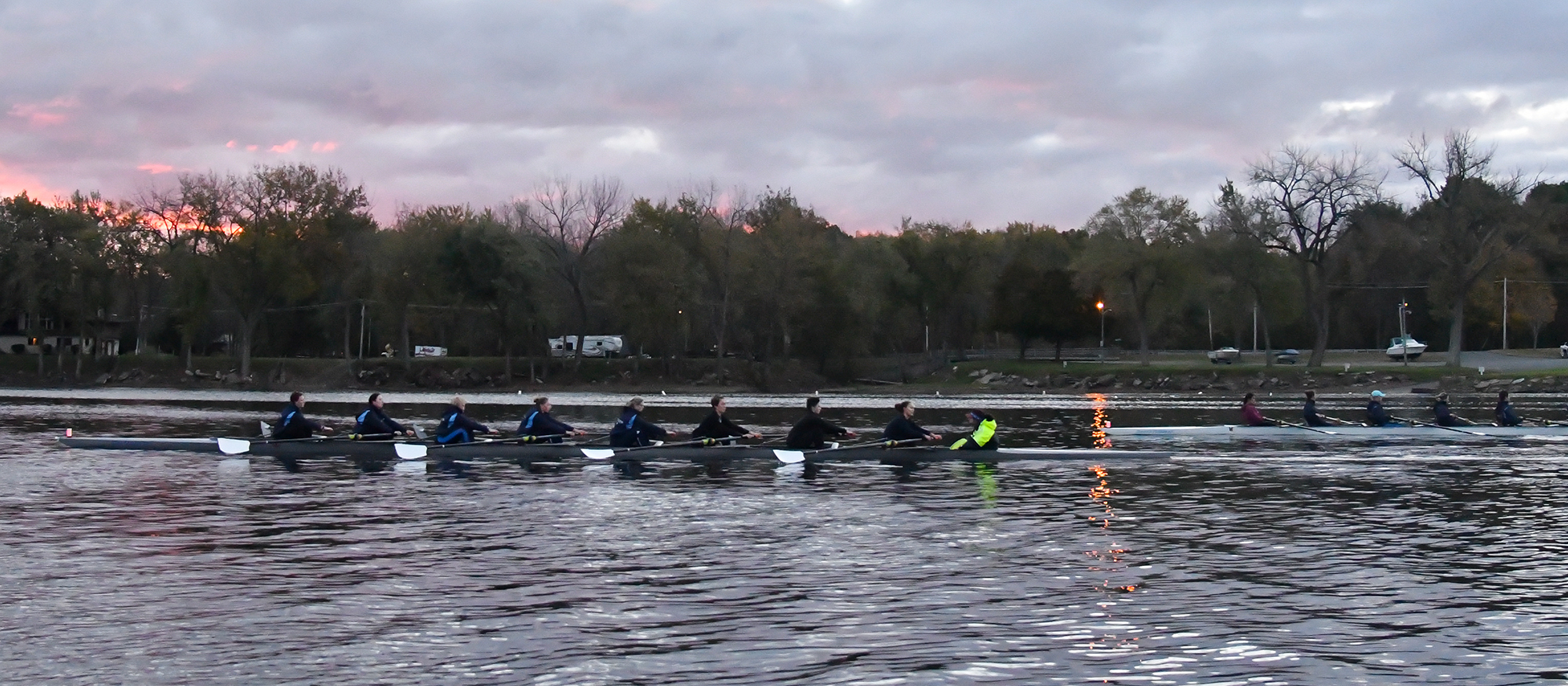 Action photo of the Lyons rowing team on the Connecticut River.