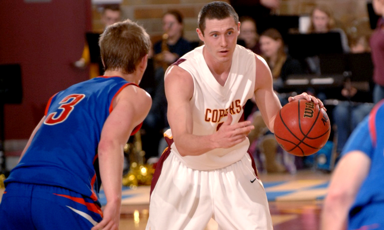 Senior Ryan Rude directs the offense on his way to a season-high 13 points in the Cobbers' 63-52 win over Macalester.
