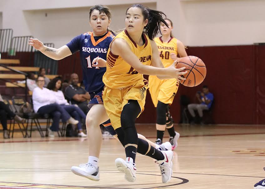 Lancer Jade Lin gets ready to fire a pass during PCC's championship final loss to College of the Sequoias at the 2nd President's Roundball Classic on Saturday, photo by Richard Quinton.