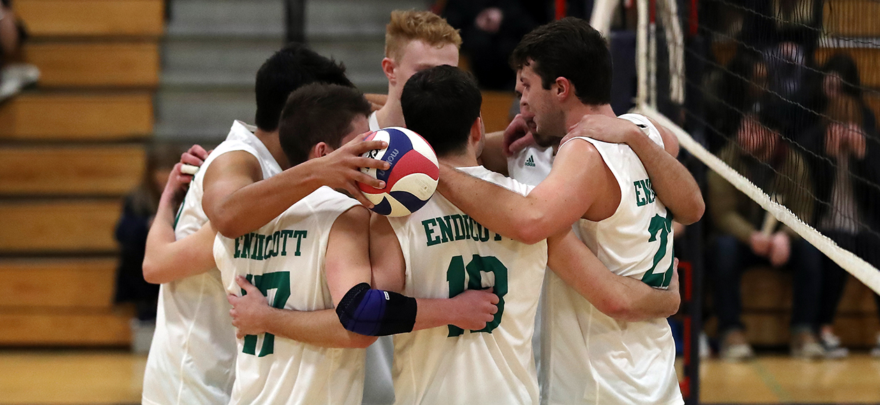 The Endicott men's volleyball team huddles up.