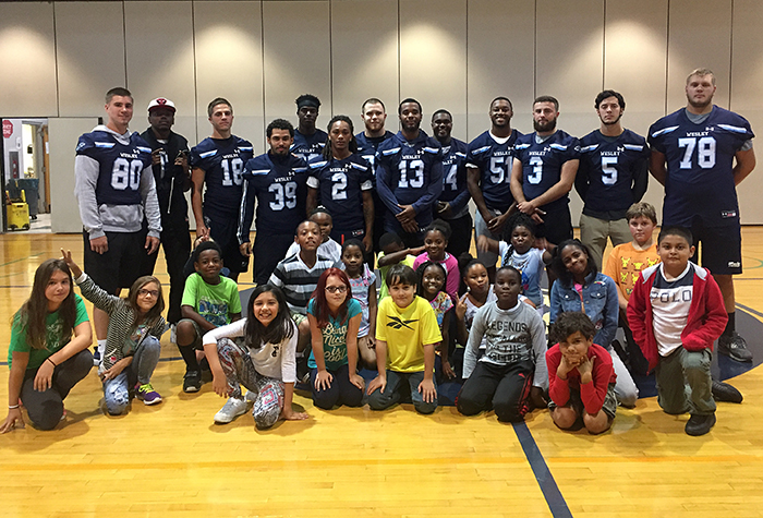 "Football takes part in ""Real Men Read"" Day"