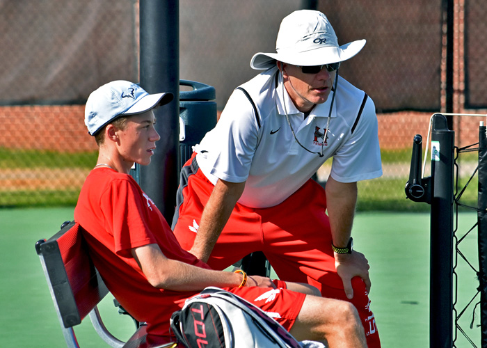Head coach Charlie Osten talks to Adam Self during a match earlier this season. (Photo by Wesley Lyle)