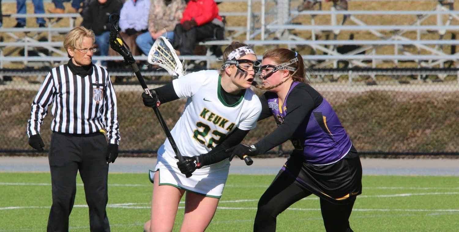 Kendall Neuberger (22) broke the school record with nine goals against Alfred -- Photo by Ed Webber
