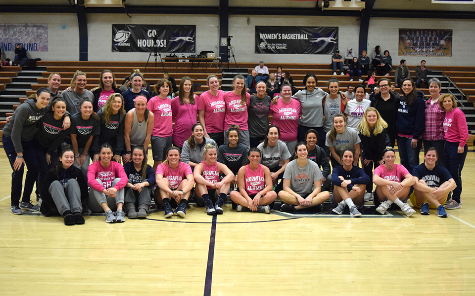 Members of the current women's basketball and former players after the annual alumni game in Johnston Hall.
