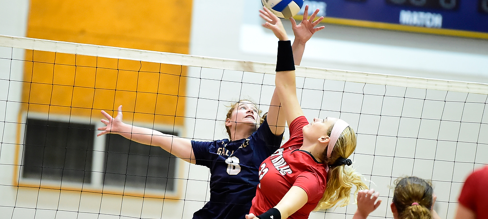 Gallaudet middle blocker Cassidy Perry goes up for a block against Catholic University