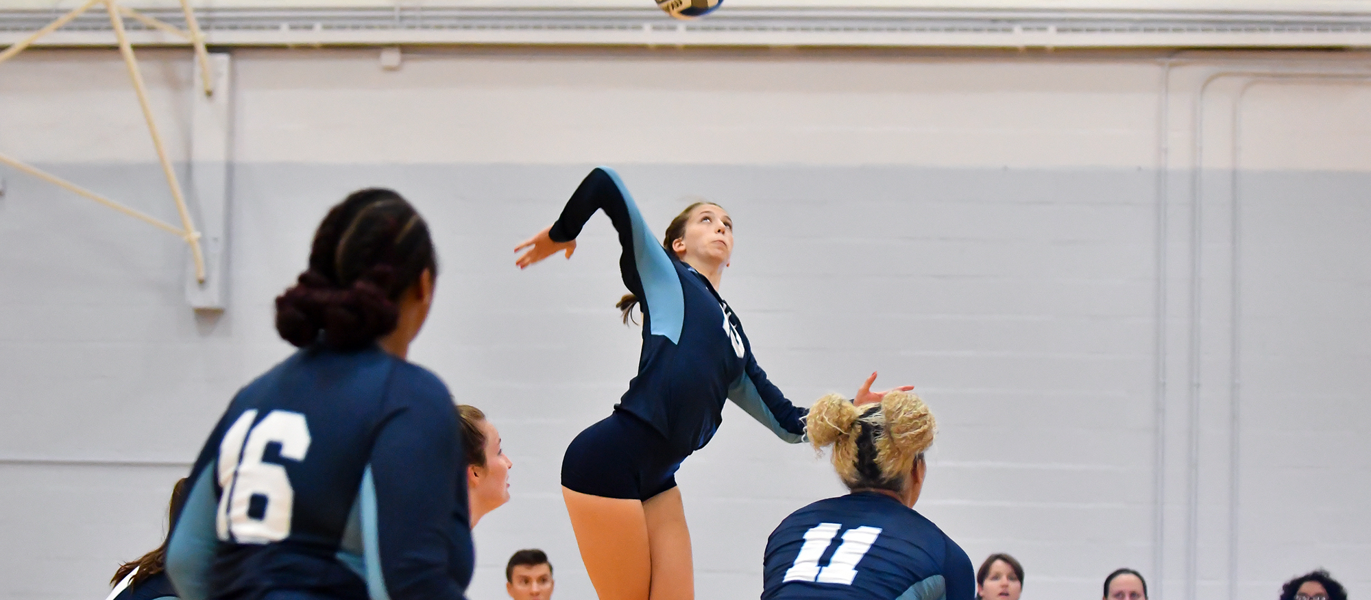 Action photo of Lyons volleyball player, Sarah Bishop