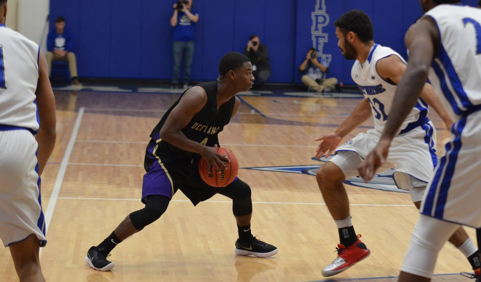 Balanced Scoring Leads Men's Basketball Past Manchester
