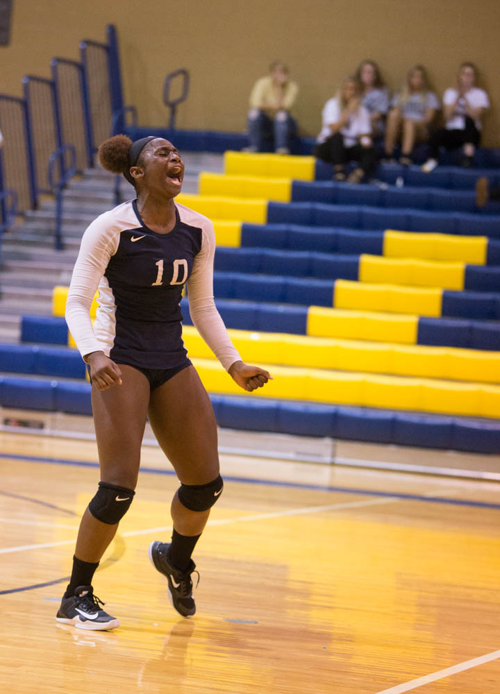 Timia Grant celebrates Wake Tech's victory over DCCC, 3 sets to 0 on Tuesday, August 22, 2017.