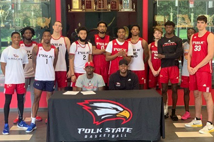 TK Smith (sitting left with Head Coach Brandon Giles) has signed a letter of intent with Georgia Southern University.
