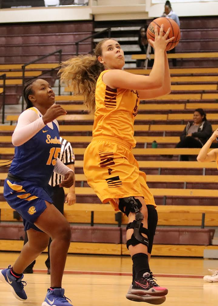 Lancer Alisa Shinn had a game for the ages when she scored 34 points and grabbed 25 rebounds in PCC's win over LA Southwest at the President's Roundball Classic on Friday afternoon, photo by Richard Quinton.