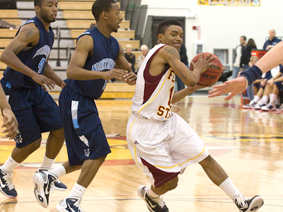 FSU's Darien Gay drives against Northwood on Saturday (Photo by Scott Whitney)