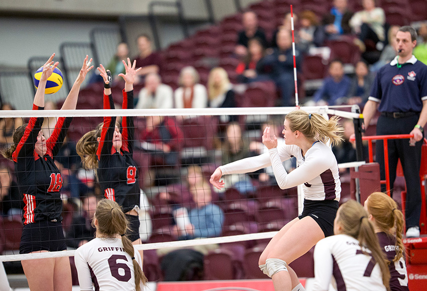 Cassidy Kinsella blasts one through the Winnipeg block on Friday night. She had 23 kills - the fourth-highest single game output of her Canada West career, which will come to an end on Saturday (Robert Antoniuk photo).