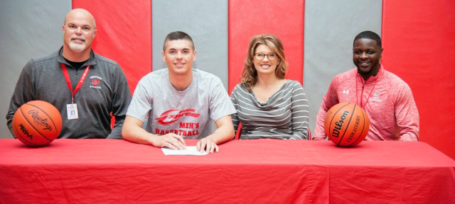 Ben German, second from left, signed with Owens recently. He is joined by Owens head coach Dennis Springs (far right), along with his parents Mark and Michelle. Photo provided to Owens Sports Information