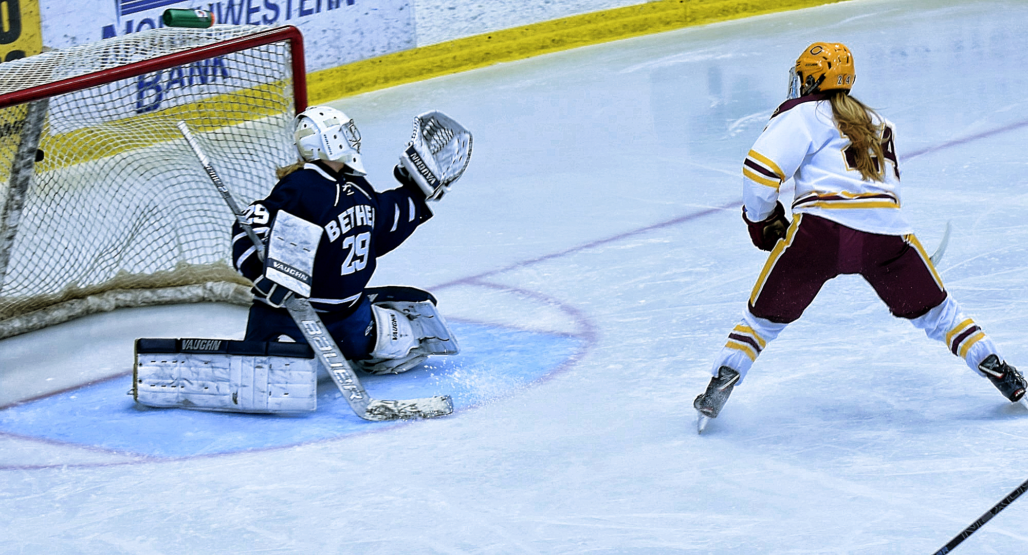 Sophomore Kaitlyn Page buries the puck in the Bethel net on a breakaway in the third period of the Cobbers' home opener.