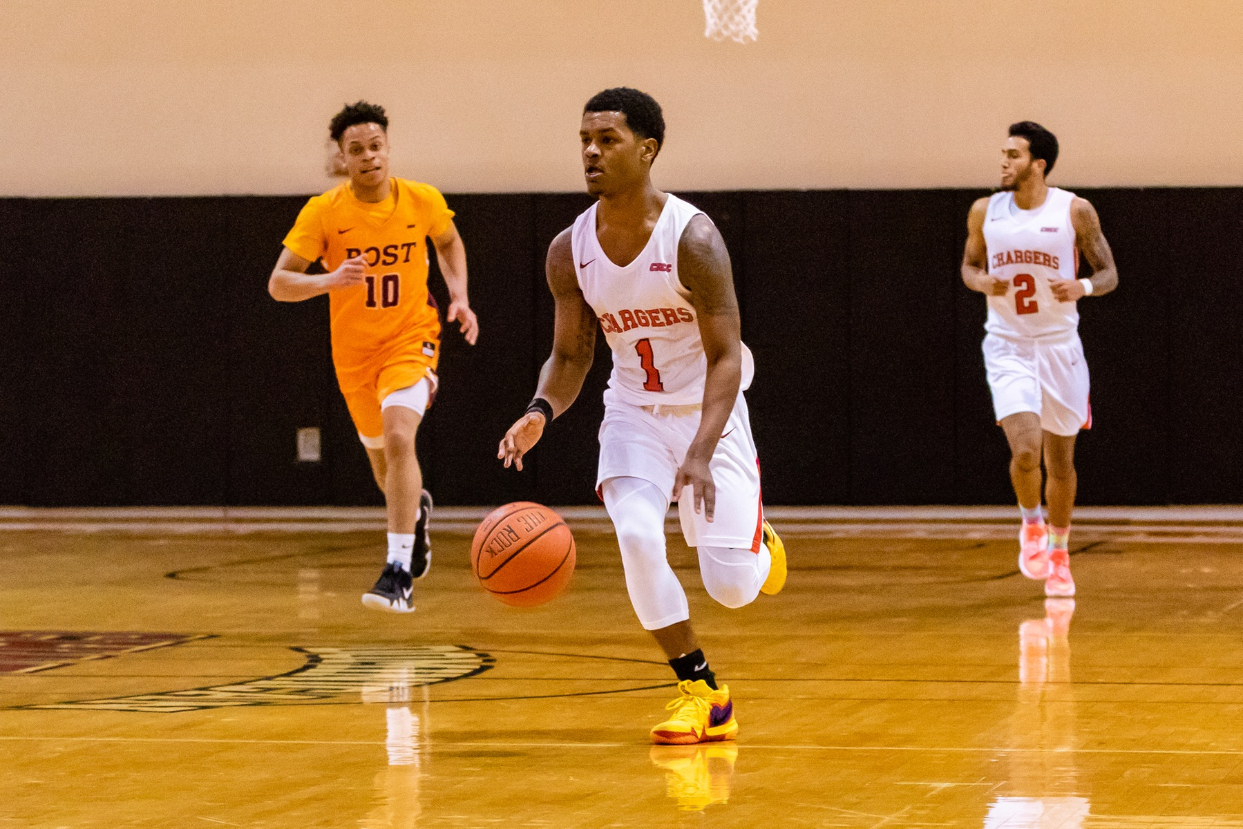 MEN'S BASKETBALL EDGED BY NEW HAVEN