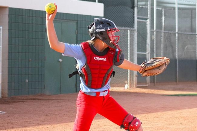 Mesa catcher, Tori Gonzalez, looks to throw a runner out at second base. (photo by Aaron Webster)