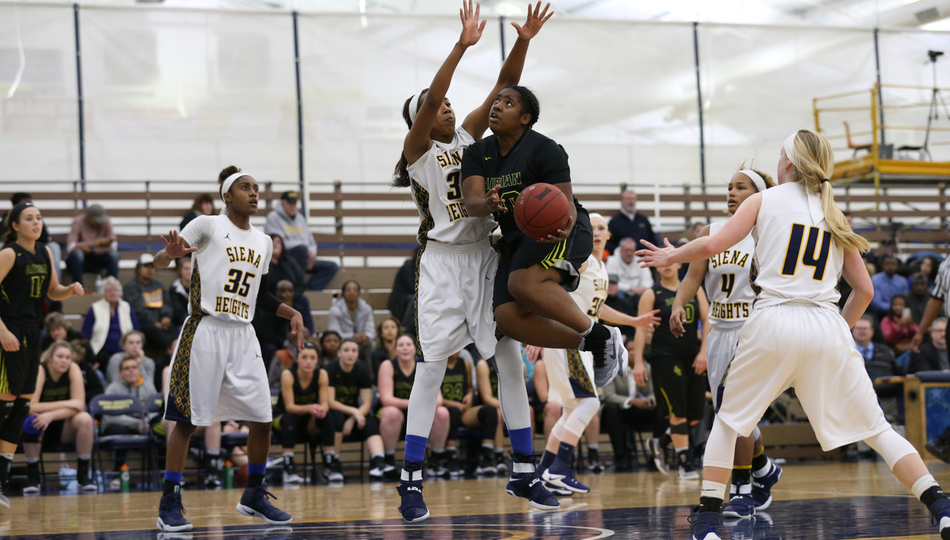 Senior Star Harris led Adrian with 11 points off the bench in Saturday's 84-49 loss to nationally-ranked Hope College. (Action photo by Mike Dickie)