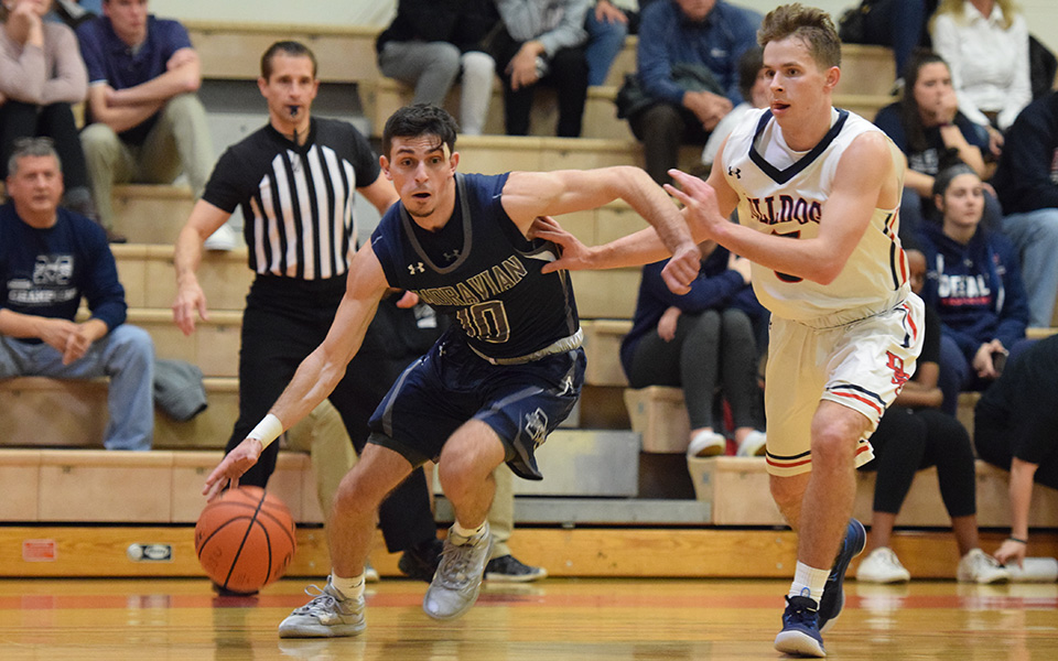 Senior Mike Martino drives towards the basket in the first half at DeSales University.