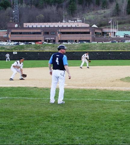SUNY Broome third baseman getting ready to field a ground ball