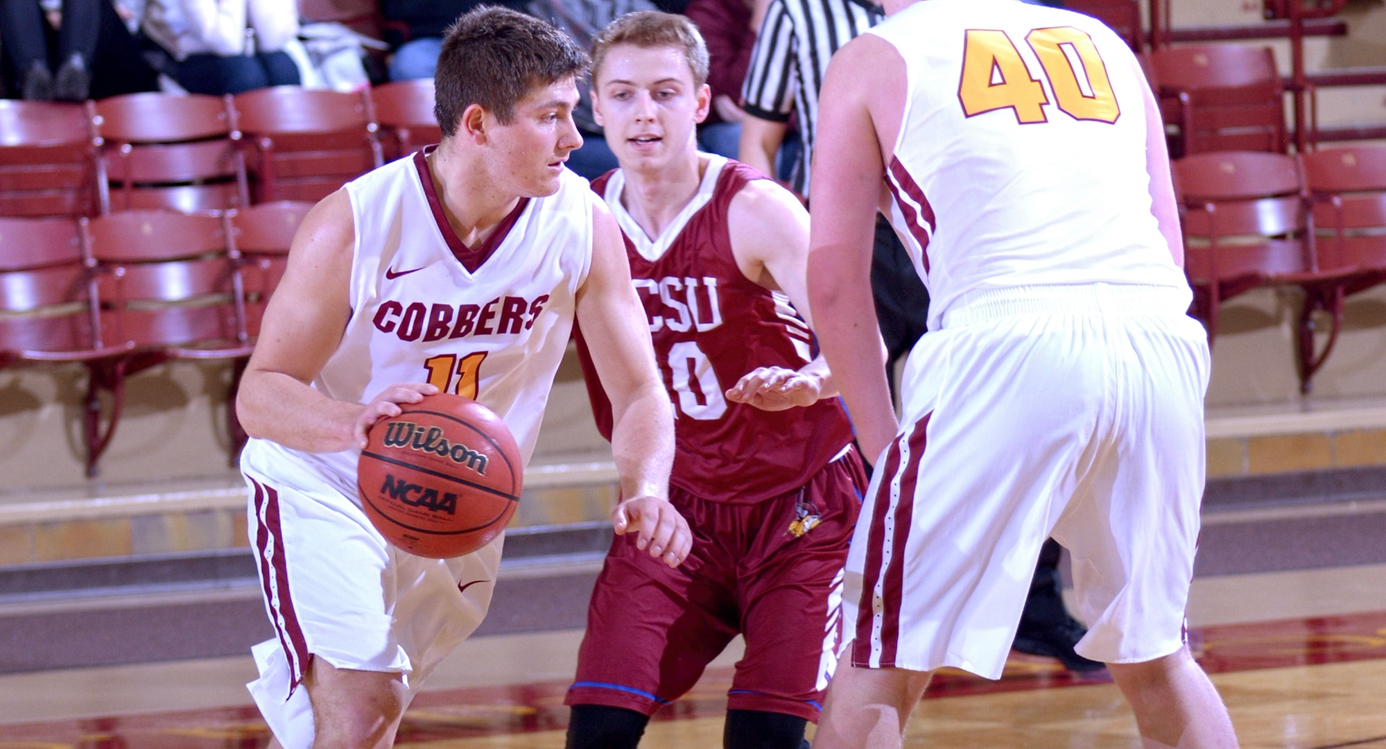 Senior Dylan Alderman drives to the basket in the Cobbers' overtime win against Valley City State. Alderman tied his career high with 27 points.