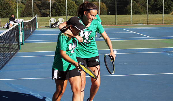 Copyright 2017; Wilmington University. All rights reserved. Photo of Andrea Ribalta (left) and Laura Gil after their victory at number one doubles against USciences.