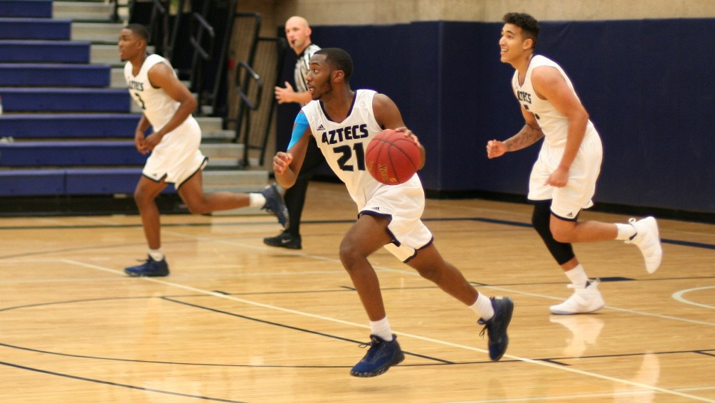 Sophomore Alize Travis was one of seven Aztecs who scored in double figures. He had 11 points and seven assists in Pima's 100-91 win at Chandler-Gilbert Community College. The Aztecs improved to 19-2 overall and 11-2 in ACCAC conference play. Photo by Stephanie Van Latum