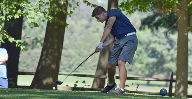 Victor Tavares '21 tees off on the ninth hole at Southmoore Golf Course in the Moravian Fall Invitational.