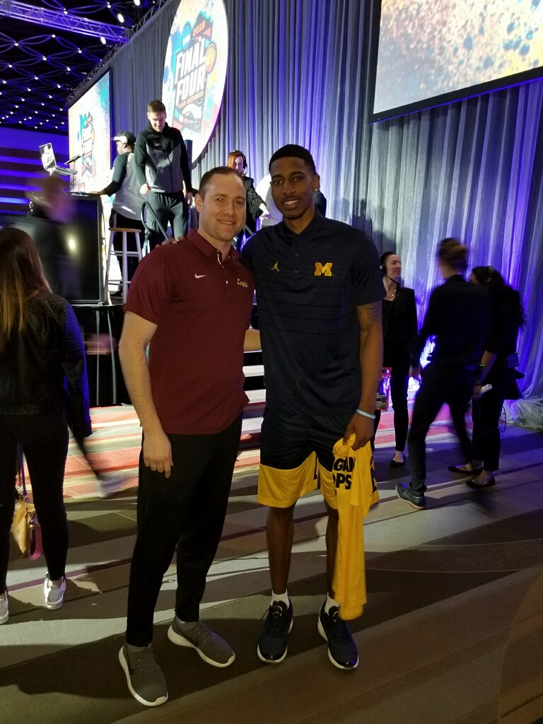 Matt Gordon '01 of Loyola & Charles Matthews '15 of Michigan take a quick picture at the Final Four. Good luck Guys!