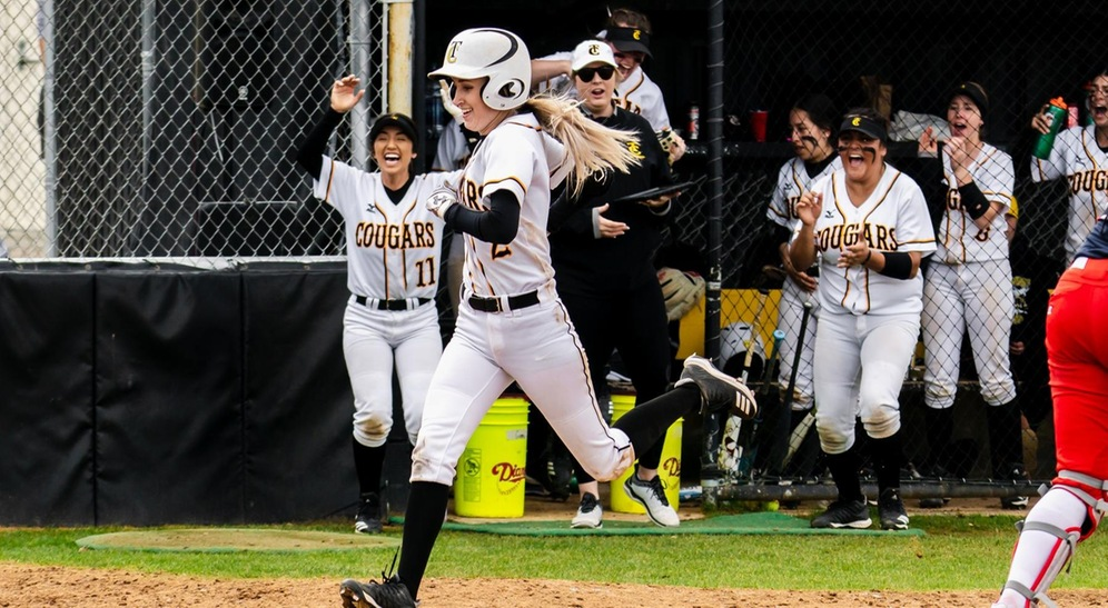 Kaitlyn Allen comes in to score on an inside-the-park home run in the Game 2 loss to Siskiyous. (Photo by Augie Duenas)