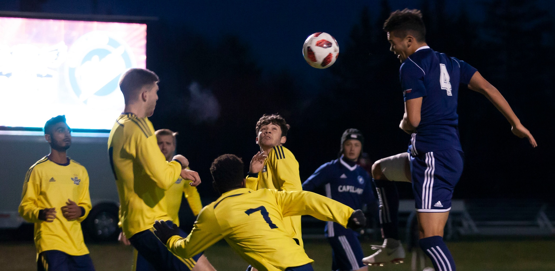 Third-year defender Andres Romo goes up for a header during Capilano's 4-0 win over NAIT in Friday's bronze semifinal match. Photo courtesy the CCAA