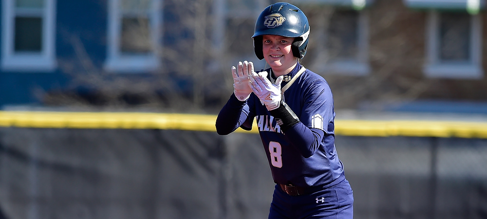 Gallaudet's Kate Lorenzo claps her hands together as she celebrates her hit for the Bison.
