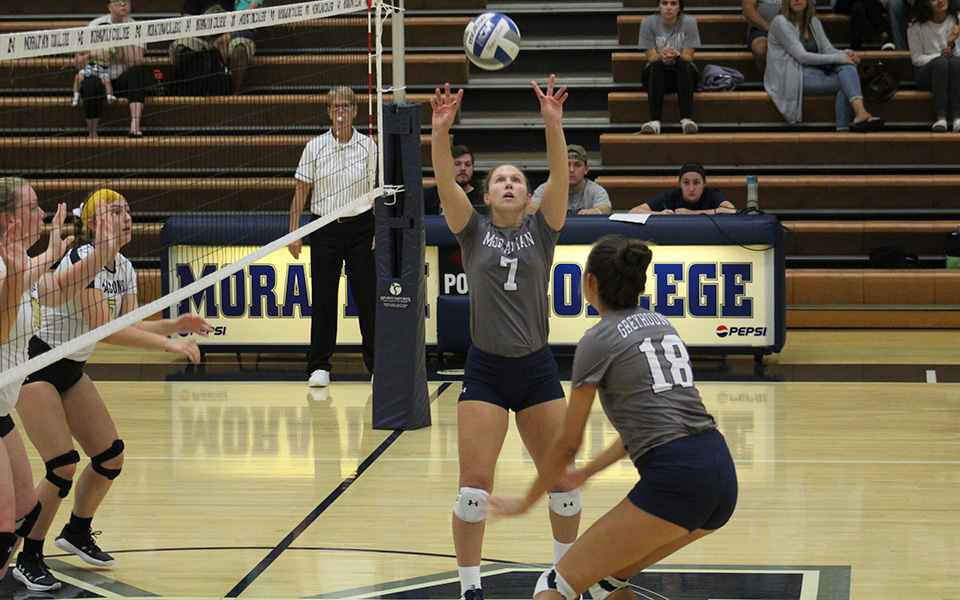 Senior Victoria Kauffman sets up an attack attempt for sophomore Renee Mapa in a match versus Cedar Crest College in Johnston Hall.