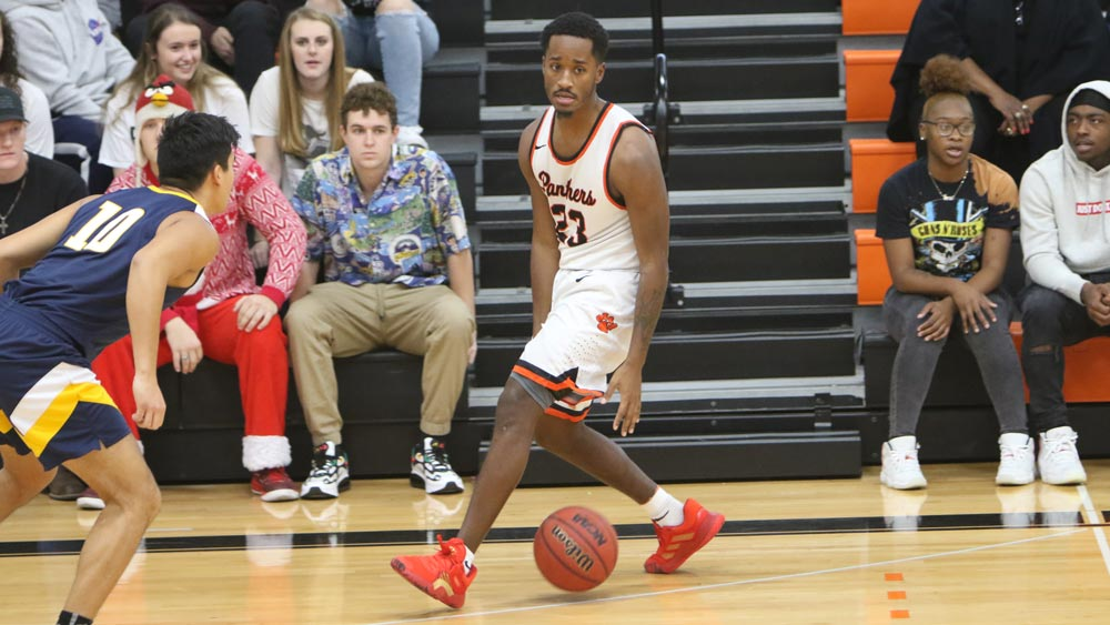 Men's basketball tops Principia on road