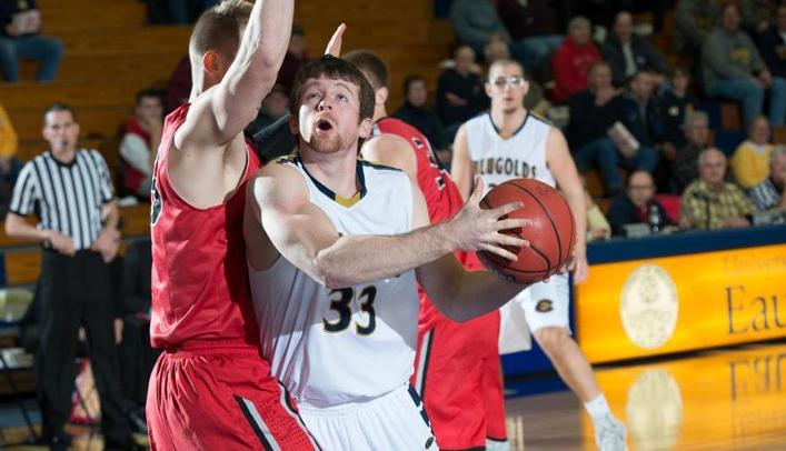 Men's Basketball Hangs on For First WIAC Win
