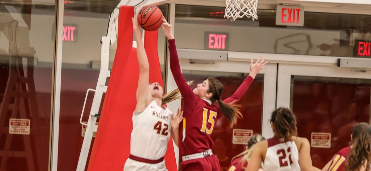 Junior forward Kate Parrish records one of her three blocks on the day (photo by Daniel Addison)