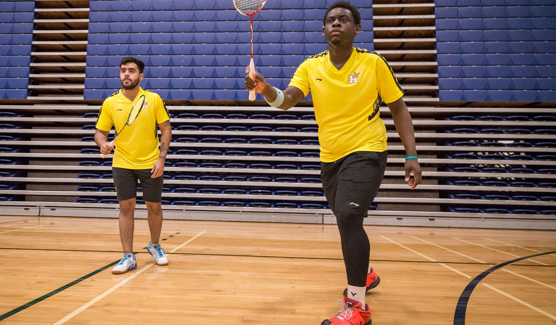 BADMINTON TEAMS PUT THEMSELVES IN POSITION TO ADVANCE TO MEDAL GAMES ON SATURDAY
