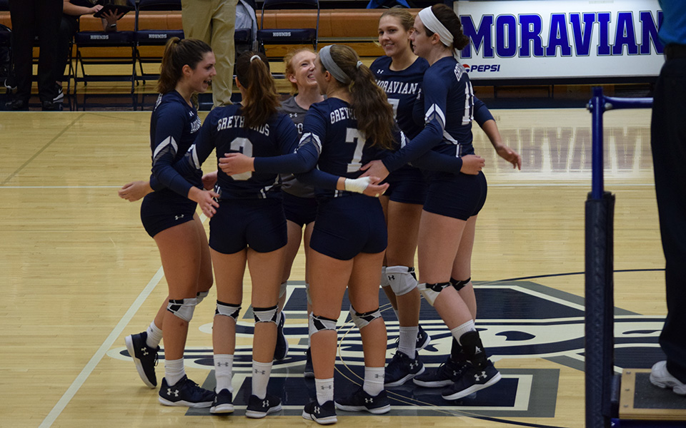 The Greyhounds celebrate a point in a win over Keystone College in Johnston Hall.