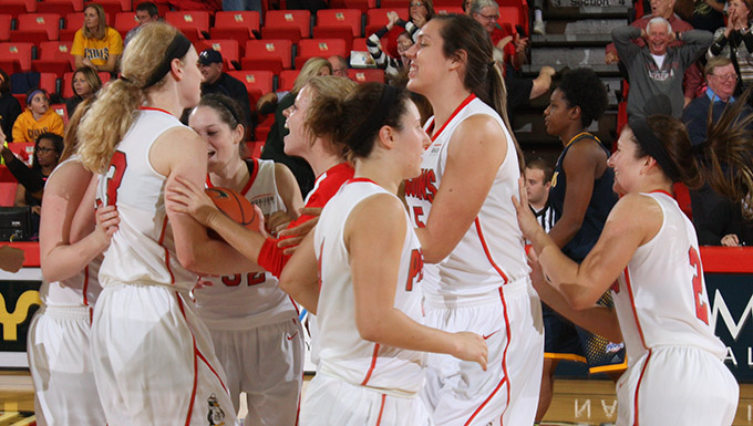 The Penguins celebrate with Sarah Cash after overcoming a 22-point deficit against Canisius.